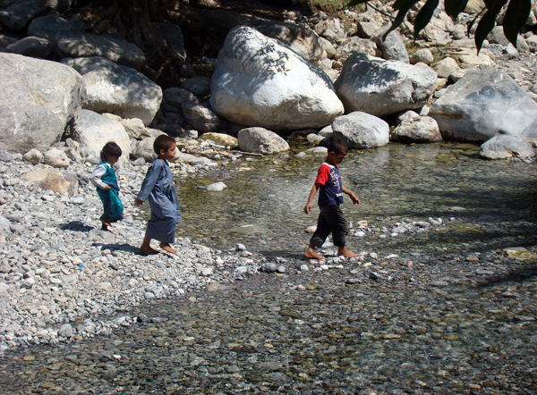 kids playing in a wadi, photo courtesy of Elite Tourism, Oman