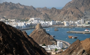 looking toward the Muttrah corniche from across the harbor, Muscat, Oman, photo courtesy of Elite Tourism